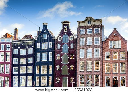 Narrow old housing buildings in Amsterdam Netherlands.