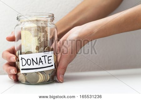 Donate donation money jar charity relief concept