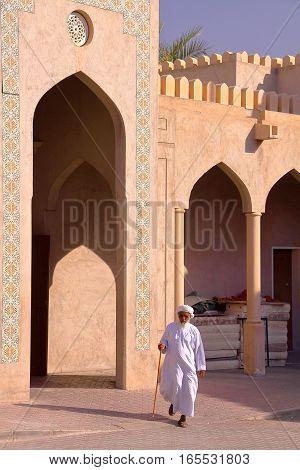 NIZWA, OMAN - FEBRUARY 2, 2012: An Omani old man traditionally dressed in Nizwa Old Town