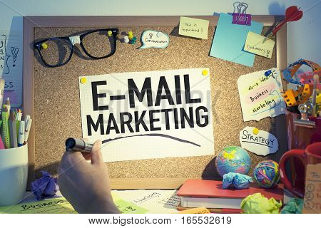 Email marketing business concept with note in office