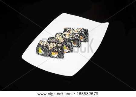 sushi rolls set of black rice with salmon avocado and Philadelphia cheese on a black background