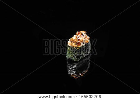 sushi spicy Gunkan with smoked eel on a black background with reflection