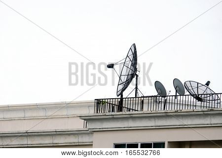 Satellite dishes installed on buildings in the city.