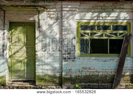 The Texture Of Old Broken Window And Worn Door, Which The Old Paint Flaking. The Texture Of Old Wind