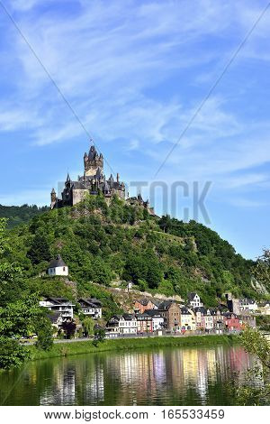 Castle Reichsburg sits above the medieval town of Cochem on the Mosel River.