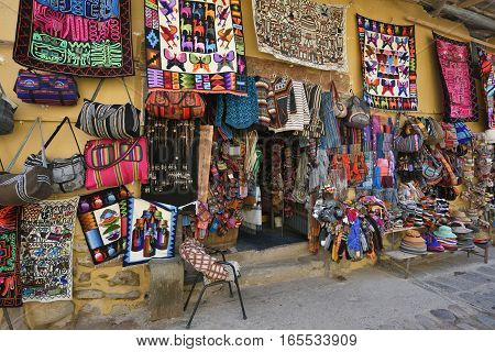 OLLANTAYTAMBO PERU - September 04 2016: Colourful goods for sale in souvenir shop in Ollantaytambo Peru on September 04 2016. Ollantaytambo is a town and an Inca archaeological site in Peru.