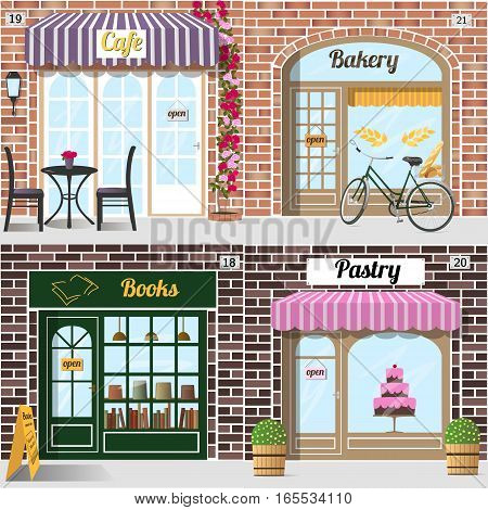 Set of different facades bakery, cafe, bookshop and pastry shop. Table, chairs, climbing rose, Bicycle with bread in basket. Row of books in the bookshop window. Big cake in pastry window. Building facade of brick.
