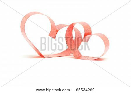 Valentines day card - heart made of ribbon on white background.