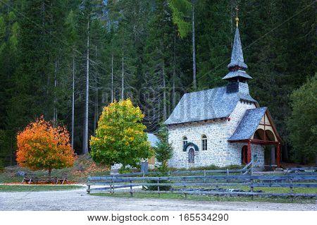 Shapel Marienkapelle at the Braies Lake (Pragser Wildsee) in Dolomites mountains Sudtirol Italy