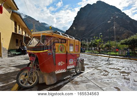 OLLANTAYTAMBO PERU - September 04 2016: Auto rickshaw on parking in Ollantaytambo Peru on September 04 2016. Ollantaytambo is a town and an Inca archaeological site in southern Peru.