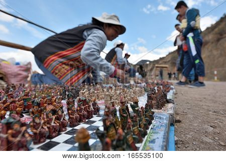 PISAC PERU - September 04 2016: Unidentified people trades traditional souvenirs in Pisac Peru on September 04 2016. Pisac is a Peruvian village in the Sacred Valley of the Incas.