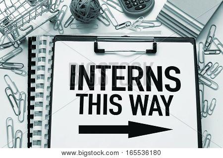 Interns this way note internship concept with text