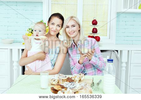 Young woman with a child on the kitchen table.