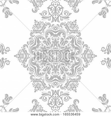 Seamless damask pattern. Traditional classic orient ornament. Light silver pattern