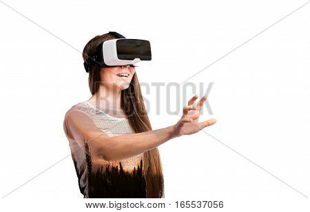 Double exposure. Beautiful woman wearing virtual reality goggles stretching arm. Nature at sunset. Isolated.