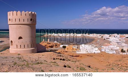 SUR, OMAN: General view of the beach of Ayjah with a watch tower in the foreground