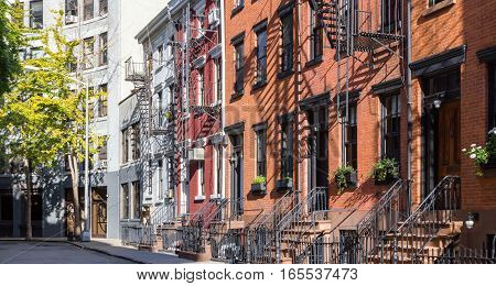 Panoramic view of colorful row of old buildings along Gay Street in the Greenwich Village neighborhood of Manhattan New York City NYC