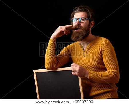Thoughtful Hipster In Glasses