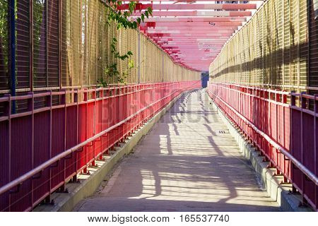 Empty pedestrian walkway across the Williamsburg Bridge between Brooklyn and Manhattan in New York City NYC