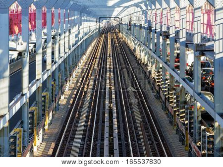 View of empty subway tracks at rush hour across the Williamsburg Bridge between Brooklyn and Manhattan in New York City NYC