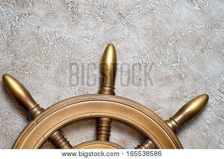 The wheel on a beige background with free space for your writing. Close up top view. Holiday concept.
