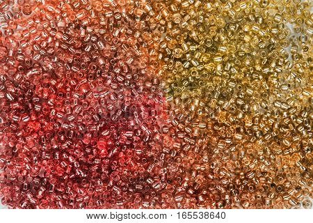 Pink and golden glass beads as a background