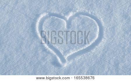 The shape of heart drawing on the white snow