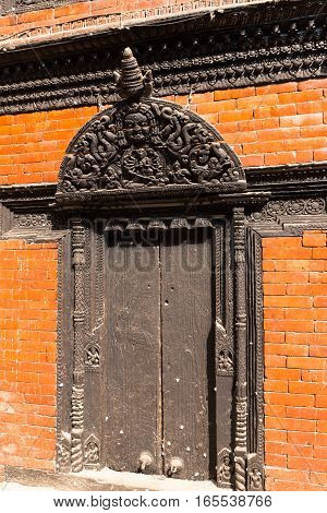Antique carved wooden gate Courtyard of Kumari Bahal in Kathmandu Durbar Square Nepal