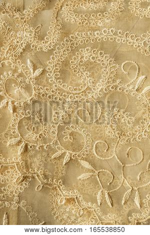 Vintage yellow lacy veil closeup as a background