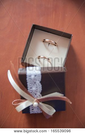 Beautiful gold wedding rings in a box