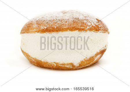 Maritozzo con la panna (roman traditional sweet bun with whipped cream) on a white background