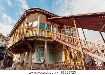 TBILISI, GEORGIA - OCT 16, 2016: Old house with wooden stairs in traditional georgian style built in historical area of city on October 16, 2016. Tbilisi has population of 1.5 million people