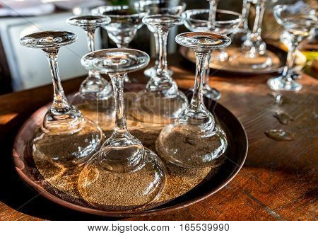 Collection of washed pure glasses on tray for cocktails