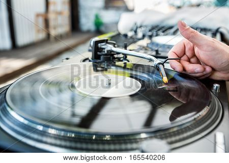 Dj Mixes The Track In Club
