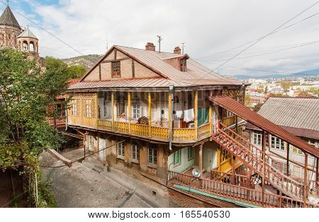 TBILISI, GEORGIA - OCT 16, 2016: Old district of georgian capital with traditional wooden houses and narrow streets on October 16, 2016. Tbilisi has a population of 1.5 million people