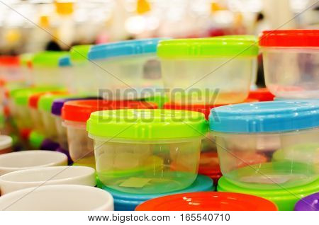 Containers for food with colored caps in a supermarket.