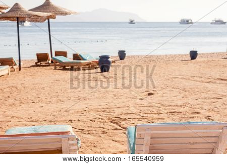 sun umbrellas and two sunbeds together at Egyptian beach