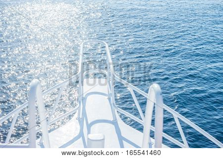 beautiful white yacht bow on blue water surface background