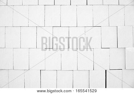 White calcium silicate bricks piled high in a stack
