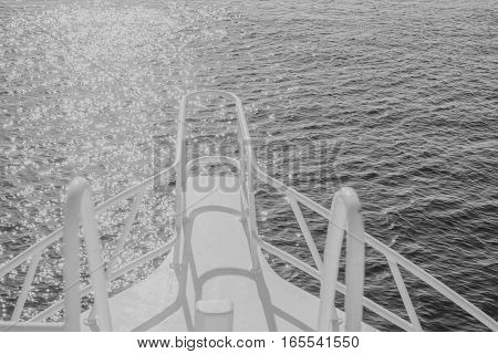 white black beautiful yacht bow on water surface background