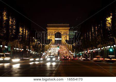 Arc de Triomphe and Champs-Elysees Avenue in Paris at dusk