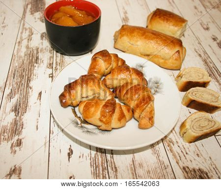 Homemade breads or bun on wood background, croissant puff cinnamon, breakfast food