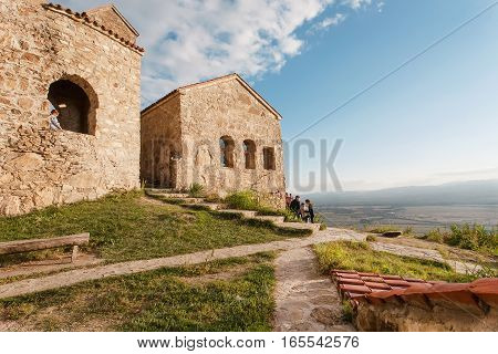 NEKRESI, GEORGIA - OCT 1, 2016: Hill top with people discovering the ancient Christian monastery in Alazani valley on October 1, 2016. Nekresi monastery was erected in 4th - 7th century