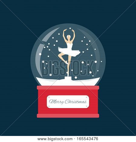 Merry christmas glass ball with a ballerina dancing in the snow. New Year gift.