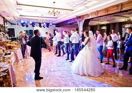 Petryky, Ukraine - May 14, 2016: Dance Wedding Party With Guests And Leading Toastmaster