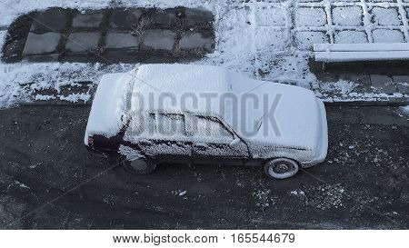 Car covered with snow in the early morning