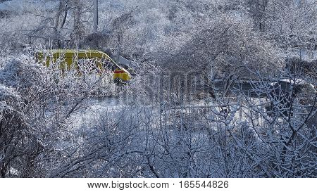 The bright colors car in a snowy yard