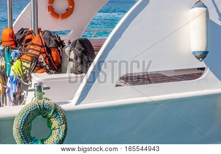 white yacht with different diving equipment for excursion