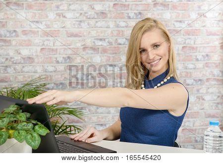 beautiful young blonde woman using a laptop