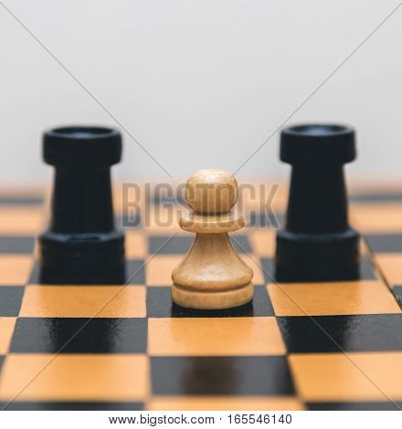 Vintage wooden chess pieces on the chess board closeup